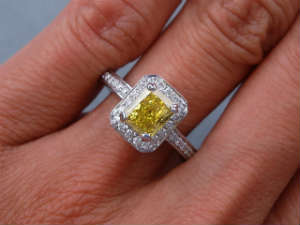 Radiant cut diamond yellow vivid ring