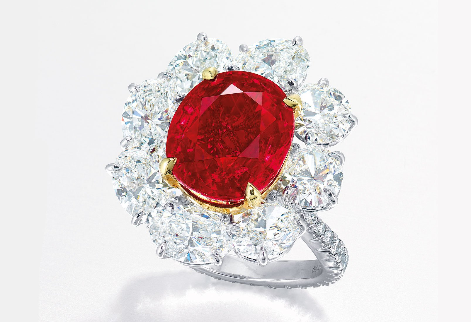 within approximately carats shaped s red oval burma ring weighing blood pigeon and a set similarly surround diamond rings an ruby with cut pin