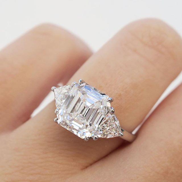 Emerald cut diamond with trillion side stones